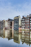 The Damrak canal in Amsterdam, Netherlands. Royalty Free Stock Photography