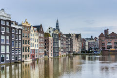 The Damrak canal in Amsterdam, Netherlands. Royalty Free Stock Images
