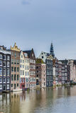 The Damrak canal in Amsterdam, Netherlands. Stock Photos