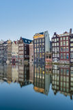The Damrak canal in Amsterdam, Netherlands. Stock Image