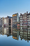 The Damrak canal in Amsterdam, Netherlands. Stock Images