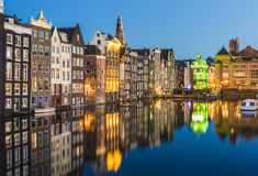 The Damrak canal in Amsterdam, Netherlands. Stock Photo