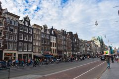 Damrak. Street in the centre of Amsterdam, between the Central train station and Dam square. Amsterdam, Netherlands, Europe - July 27, 2017. Damrak. Street in royalty free stock image