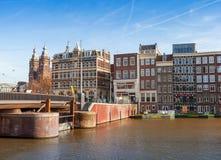 Damrak street in historical center of Amsterdam Stock Photos