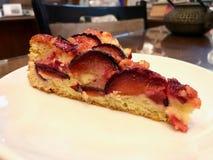 Damson Plum Cake Tart served at Coffee Shop stock image