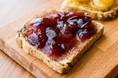 Damson Plum Jam on bread with Apricot jam. Royalty Free Stock Photography
