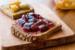 Damson Plum Jam on bread with Apricot jam. Organic Food Royalty Free Stock Image