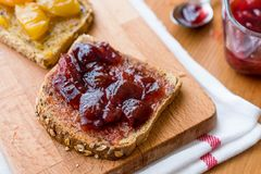 Damson Plum Jam on bread with Apricot jam. Royalty Free Stock Image