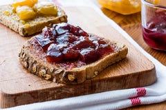 Damson Plum Jam on bread with Apricot jam. Organic Food Royalty Free Stock Photos