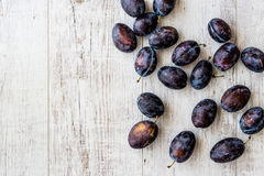 Damson Plum on white wooden surface. Organic food concept Royalty Free Stock Photography