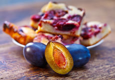 Damson plums and cake Royalty Free Stock Photography