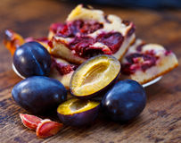 Damson plums and cake Stock Photography