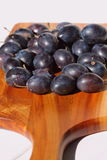 Damsons on wooden chopping board D Stock Photos