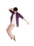 Dança asiática do homem em seus dedos do pé Imagem de Stock