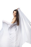 Dança da jovem mulher no vestido branco lindo Foto de Stock