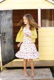 Dança da menina com um vestido Imagem de Stock Royalty Free