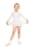 Dança da menina em um vestido de bola branco imagem de stock royalty free