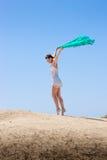 Dança da menina no vento Imagem de Stock Royalty Free