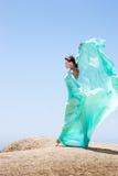Dança da menina no vento Fotografia de Stock Royalty Free