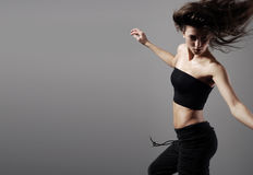 Dança de um breunette novo e bonito Foto de Stock Royalty Free