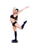 Dança perfeita da mulher da forma do corpo na escala do peso Foto de Stock