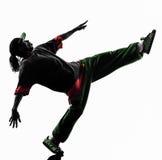 Dançarino acrobático da ruptura do hip-hop que breakdancing a silhueta do homem novo fotografia de stock