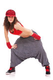 Dançarino com o tampão do lúpulo do quadril e as grandes calças imagens de stock