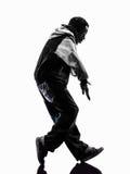 Dançarino moonwalking da ruptura do hip-hop que breakdancing o silhouet do homem novo fotografia de stock
