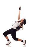 Dançarino no vestuário do lúpulo do quadril que golpeia um pose Foto de Stock