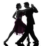 Dançarinos do salão de baile da mulher do homem dos pares que tangoing a silhueta Imagem de Stock