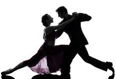 Dançarinos do salão de baile da mulher do homem dos pares que tangoing a silhueta Fotos de Stock Royalty Free