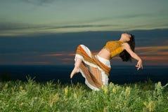 Danças do por do sol Fotos de Stock Royalty Free