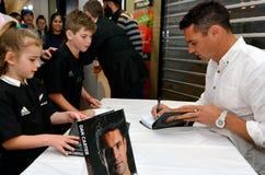 Dan Carter signing copies of his book Stock Photography