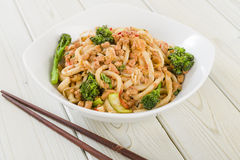 Dan Dan Noodles. Chinese noodles with minced pork and sprouting broccoli in a fragrant spicy sauce. Sichuan cuisine royalty free stock photography