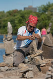 Dan Davis at Stone Balancing Festival Royalty Free Stock Photos