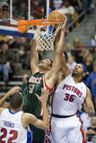 Dan Gadzuric and Rasheed Wallace. Dan Gadzuric of the Milwaukee Bucks is blocked by Rasheed Wallace during a game against the Detroit Pistons, in Auburn Hills Stock Photos