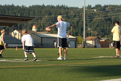 Dan Looker involved in Youth Football camp Stock Image