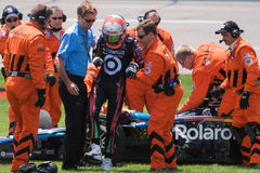 Dan Wheldon. Members of the IRL Delphi Safety Team assist Dan Wheldon after his wreck during practice for the the Indy Racing League Bombardier Learjet 550k at Royalty Free Stock Photos