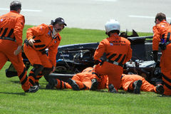 Dan Wheldon. Members of the IRL Delphi Safety Team assist Dan Wheldon after his wreck during practice for the the Indy Racing League Bombardier Learjet 550k at Stock Photo