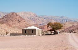 Mountains, dirt road, desert, landscape, climate change, Dana Biosphere Reserve, Jordan, Middle East. Middle East, 03/10/2013: building and desert landscape in stock photography