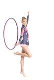 Dança da ginástica da mostra da rapariga com aro Fotografia de Stock Royalty Free