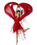 Dança da mulher com o pano dado forma coração da tela, vestido vermelho da menina Fotos de Stock Royalty Free