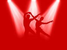 Dança no projector Fotografia de Stock Royalty Free