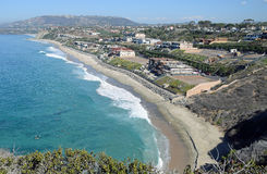 Dana Strand Beach in Dana Point, California. Image shows the Dana Strand Beach in Dana Point, California. The location is below the Dana Point Headlands royalty free stock photo