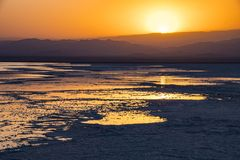 Sunset at Lake Assale, Ethiopia. The Danakil depression — specifically the area surrounding Lake Afdera — is the place from which close to 100% of the salt Stock Image