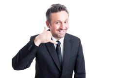 Danande för affärsmannen kallar oss eller kontaktar gest Royaltyfri Bild
