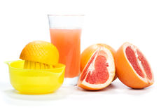 Danandegrapefruktfruktsaft, på vit Arkivbild
