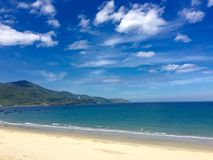 Danang Bay by day. Vietnam asia landscape mountain clouds sky white blue green sea ocean sand beautiful nature travelling Royalty Free Stock Photography
