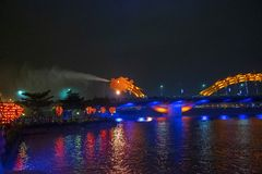 Danang bridge dragon spews water in the dark of night surrounded by the crowd of spectators. Danang bridge dragon spews water in the dark of night vietnam city royalty free stock photography