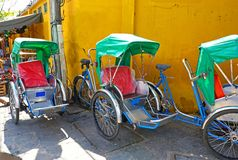 Danang, Vietnam.  Old town with Colourful Pedicabs waiting Stock Image